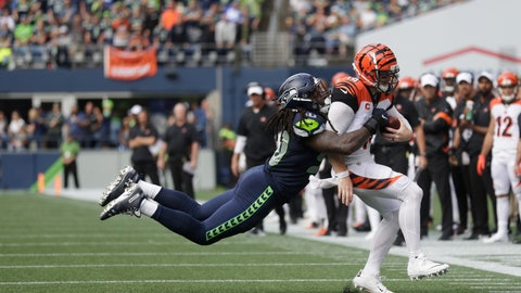 <p>               Seattle Seahawks defensive end Jadeveon Clowney, left, tackles Cincinnati Bengals quarterback Andy Dalton, right, during the second half of an NFL football game, Sunday, Sept. 8, 2019, in Seattle. (AP Photo/Stephen Brashear)             </p>