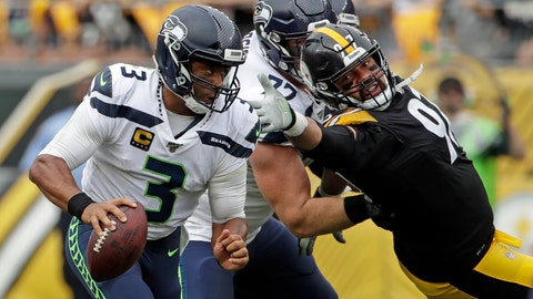 <p>               Seattle Seahawks quarterback Russell Wilson (3) scrambles past Pittsburgh Steelers defensive end Cameron Heyward (97), who is blocked by Seahawks offensive guard Ethan Pocic (77) during the second half of an NFL football game in Pittsburgh, Sunday, Sept. 15, 2019. The Seahawks won 28-26. (AP Photo/Gene J. Puskar)             </p>