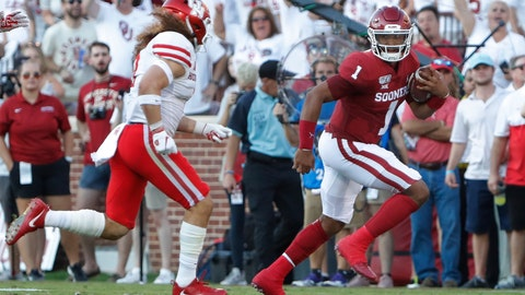 <p>               Oklahoma quarterback Jalen Hurts (1) runs the ball against Houston during the first half of an NCAA college football game in Norman, Okla., Sunday, Sept. 1, 2019. (AP Photo/Alonzo Adams)             </p>