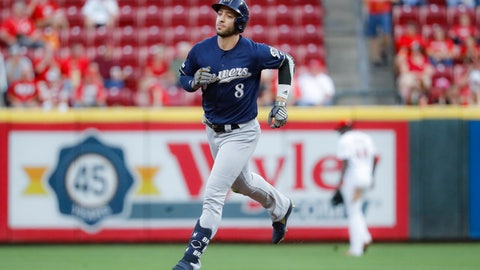 <p>               Milwaukee Brewers' Ryan Braun runs the bases after hitting a solo home run during the second inning of the team's baseball game against the Cincinnati Reds, Tuesday, Sept. 24, 2019, in Cincinnati. (AP Photo/John Minchillo)             </p>