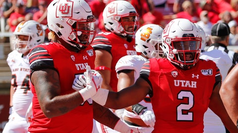 <p>               Utah running back Zack Moss (2) celebrates with teammate Nick Ford, left, after scoring against Idaho State in the first half of an NCAA college football game Saturday, Sept. 14, 2019, in Salt Lake City. (AP Photo/Rick Bowmer)             </p>