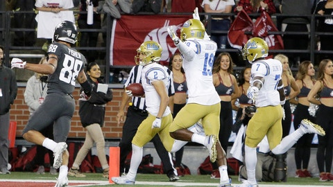 <p>               UCLA wide receiver Kyle Philips (2) returns a punt for a touchdown in front of teammates Alex Johnson (19), Mo Osling III (7) and Washington State wide receiver Rodrick Fisher (88) during the second half of an NCAA college football game in Pullman, Wash., Saturday, Sept. 21, 2019. UCLA won 67-63. (AP Photo/Young Kwak)             </p>