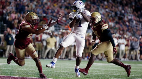 <p>               Kansas running back Pooka Williams Jr. (1) scores against Boston College defensive back Mehdi El Attrach (25) and linebacker John Lamot (28) during the second half of an NCAA college football game in Boston, Friday, Sept. 13, 2019. (AP Photo/Michael Dwyer)             </p>