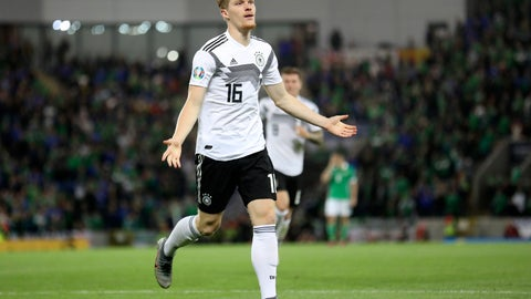 <p>               Germany's Marcel Halstenberg celebrates after scoring the opening goal during the Euro 2020 group C qualifying soccer match between Northern Ireland and Germany at Windsor Park, Belfast, Northern Ireland, Monday, Sept. 9, 2019. (AP Photo/Peter Morrison)             </p>