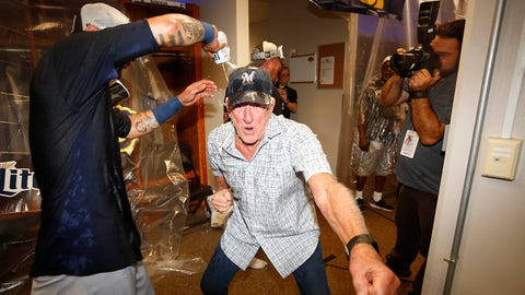 Sep 25, 2019; Cincinnati, OH, USA; Sportscaster Bob Uecker celebrates in the clubhouse after the Milwaukee Brewers clinched a playoff berth defeating the Cincinnati Reds at Great American Ball Park. Mandatory Credit: David Kohl-USA TODAY Sports