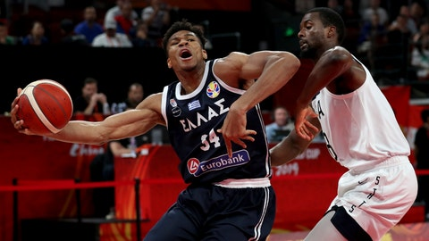 <p>               Greece's Giannis Antetokounmpo tries to get past United States' Harrison Barnes during phase two of the FIBA Basketball World Cup at the Shenzhen Bay Sports Center in Shenzhen in southern China's Guangdong province on Saturday, Sept. 7, 2019.United States beat Greece 69-53. (AP Photo/Ng Han Guan)             </p>