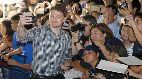 <p>               New Zealand's Beauden Barrett, left, takes a selfie with fans as the All Blacks team arrives at a camp venue for the Rugby World Cup in Kashiwa, near Tokyo, Monday, Sept. 9, 2019. (Kyodo News via AP)             </p>
