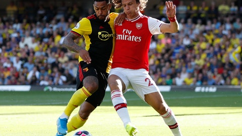 <p>               Arsenal's David Luiz, right, vies for the ball with Watford's Abdoulaye Doucoure during the English Premier League soccer match between Watford and Arsenal at the Vicarage Road stadium in Watford near London, Sunday, Sept. 15, 2019. (AP Photo/Alastair Grant)             </p>