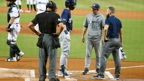 <p>               Milwaukee Brewers' Christian Yelich, second from left, is checked on by home plate umpire Kerwin Danley, manager Craig Counsell, second from right, and a trainer after an injury while batting during the first inning of the team's baseball game against the Miami Marlins, Tuesday, Sept. 10, 2019, in Miami. Yelich broke his right kneecap on a foul ball and will miss the rest of the regular season. (AP Photo/Wilfredo Lee)             </p>