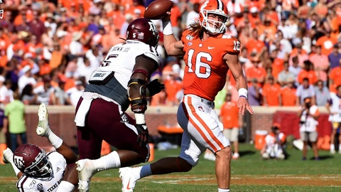 <p>               Clemson quarterback Trevor Lawrence (16) passes while pressured by Texas A&M's Bobby Brown during the first half of an NCAA college football game Saturday, Sept. 7, 2019, in Clemson, S.C. (AP Photo/Richard Shiro)             </p>