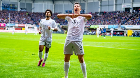 <p>               Bayern's Robert Lewandowski, front, celebrates after scoring his side's third goal during the German Bundesliga soccer match between SC Paderborn 07 and FC Bayern Munich in Paderborn, Germany, Saturday, Sept. 28, 2019. (David Inderlied/dpa via AP)             </p>