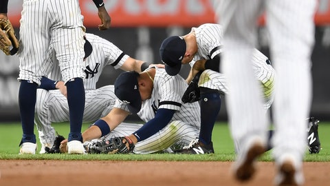 <p>               New York Yankees second baseman Gleyber Torres sits on the ground after slipping while trying to field a ground ball during the fourth inning of the team's baseball game against the Toronto Blue Jays, Friday, Sept. 20, 2019, in New York. (AP Photo/Sarah Stier)             </p>