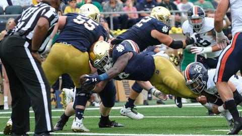 <p>               Notre Dame running back Tony Jones Jr. (6) scores while being tackled by Virginia safety Joey Blount (29) in the first half of an NCAA college football game in South Bend, Ind., Saturday, Sept. 28, 2019. (AP Photo/AJ Mast)             </p>