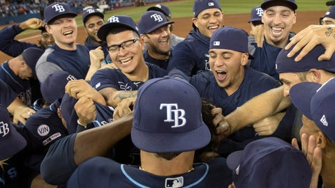 <p>               Tampa Bay Rays players celebrate on the field after they defeated the Toronto Blue Jays and clinched an MLB American League wild-card berth in Toronto, Friday, Sept. 27, 2019. (Fred Thornhill/The Canadian Press via AP)             </p>