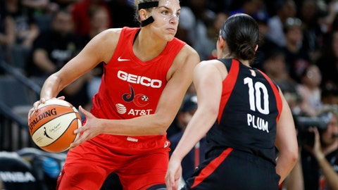 <p>               Washington Mystics' Elena Delle Donne passes around Las Vegas Aces' Kelsey Plum during the second half in Game 3 in the semifinals of the WNBA playoffs, Sunday, Sept. 22, 2019, in Las Vegas. (AP Photo/John Locher)             </p>