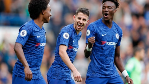 <p>               Chelsea's Jorginho, center , Chelsea's Tammy Abraham, right, and Chelsea's Willian celebrate after scoring their side's first goal during the English Premier League soccer match between Chelsea and Brighton & Hove Albion at Stamford Bridge stadium in London, Saturday, Sept. 28, 2019.(AP Photo/Frank Augstein)             </p>