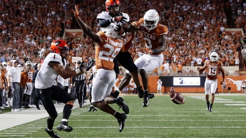 <p>               Texas defensive back Josh Thompson (29) and defensive back Jalen Green (3) break up a pass intended for Oklahoma State wide receiver Tylan Wallace (2) during the first half of an NCAA college football game Saturday, Sept. 21, 2019, in Austin, Texas. (AP Photo/Eric Gay)             </p>