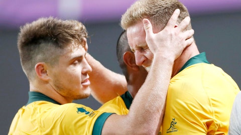 <p>               Australia's Reece Hodge, right, is congratulated by teammates after scoring a try during the Rugby World Cup Pool D game at Sapporo Dome between Australia and Fiji in Sapporo, northern Japan, Saturday, Sept. 21, 2019. (Naoya Osato/Kyodo News via AP)             </p>