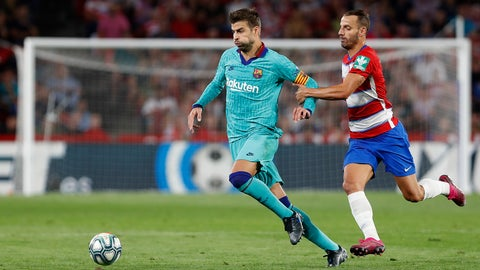 <p>               Barcelona's Gerard Pique, left, and Granada's Roberto Soldado fight for the ball during the Spanish La Liga soccer match between Barcelona and Granada at the Los Carmenes stadium in Granada, Spain, Saturday, Sept. 21, 2019. (AP Photo/Miguel Morenatti)             </p>