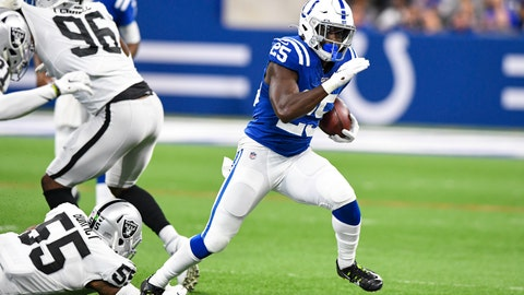 <p>               Indianapolis Colts running back Marlon Mack (25) breaks way from Oakland Raiders outside linebacker Vontaze Burfict (55) during the first half of an NFL football game in Indianapolis, Sunday, Sept. 29, 2019. (AP Photo/Doug McSchooler)             </p>