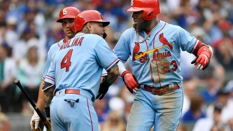 <p>               St. Louis Cardinals' Marcell Ozuna, right, celebrates with teammates Yadier Molina, left, and Paul Goldschmidt, center, after hitting a two-run home run during the seventh inning of baseball game against the Chicago Cubs Saturday, Sept. 21, 2019, in Chicago. (AP Photo/Paul Beaty)             </p>