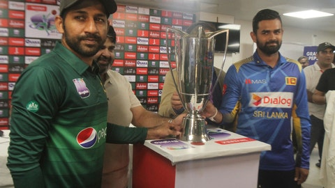 <p>               Sri Lanka captain Lahiru Thirimanne, right, and his Pakistani rival Sarfaraz Ahmed stand with a trophy, in Karachi, Pakistan, Thursday, Sept. 26, 2019. Thirimanne wants the focus to move from security in Pakistan to the cricket itself when their three-match ODI series starts Friday. (AP Photo/Fareed Khan)             </p>