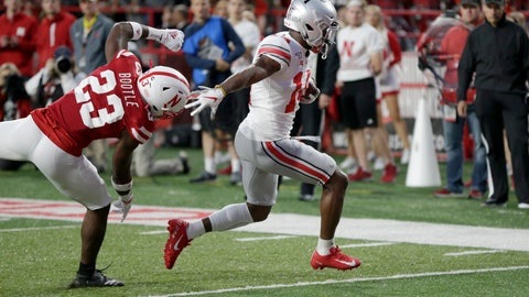 <p>               Ohio State wide receiver K.J. Hill (14) runs for a touchdown in front of Nebraska cornerback Dicaprio Bootle (23) during the first half of an NCAA college football game in Lincoln, Neb., Saturday, Sept. 28, 2019. (AP Photo/Nati Harnik)             </p>