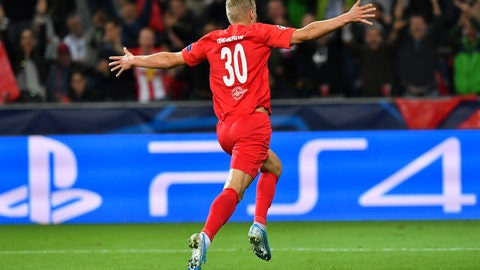 <p>               FC Red Bull Salzburg Erling Braut Haland celebrates his second goal against KRC Genk during the Champions League Group E against in Salzburg, Austria, Tuesday, Sept. 17, 2019. (AP Photo/Kerstin Joensson)             </p>