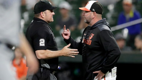 <p>               Baltimore Orioles manager Brandon Hyde, right, talks to home plate umpire Dan Bellino after Orioles' Renato Nunez was thrown out by Toronto Blue Jays' Bo Bichette at first base to end the third inning of a baseball game, Thursday, Sept. 19, 2019, in Baltimore. (AP Photo/Julio Cortez)             </p>
