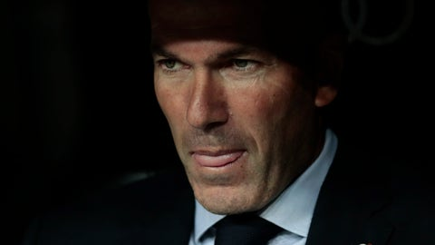 <p>               Real Madrid's head coach Zinedine Zidane sits at the bench during the Spanish La Liga soccer match between Real Madrid and Osasuna at the Santiago Bernabeu stadium in Madrid, Spain, Wednesday, Sept. 25, 2019. (AP Photo/Bernat Armangue)             </p>