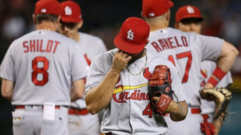 <p>               St. Louis Cardinals relief pitcher Junior Fernandez, right, walks back to the dugout after being taking out of the baseball game by manager Mike Shildt (8) after giving up four runs against the Arizona Diamondbacks during the sixth inning Wednesday, Sept. 25, 2019, in Phoenix. (AP Photo/Ross D. Franklin)             </p>