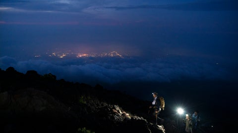 <p>               Climbers make their way along the Yoshida trail toward the summit of Mount Fuji as the glow from the town's lights are visible through clouds Friday, Aug. 2, 2019, in Japan. (AP Photo/Jae C. Hong)             </p>