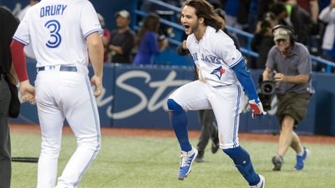 <p>               Toronto Blue Jays designated hitter Bo Bichette, front right, rounds the bases after hitting a walkoff home run to defeat the New York Yankees in the 12th inning of a baseball game in Toronto, Friday, Sept. 13, 2019. (Fred Thornhill/The Canadian Press via AP)             </p>