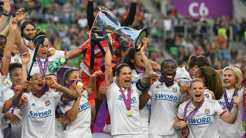 <p>               FILE - In this Saturday, May 18, 2019 file photo, Olympique Lyon players celebrate with the trophy after they defeated FC Barcelona 4-1 in the women's soccer Champions League final match at the Groupama Arena in Budapest, Hungary. Four-time defending champion Lyon has been drawn to play Fortuna Hjørring in the round of 16 of the Women's Champions League, it was announced Monday, Sept. 30, 2019. Fortuna Hjorring was the beaten finalist in the 2003 edition of UEFA's continental championship. (Tibor Illyes/MTI via AP, file)             </p>