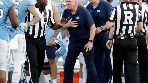 <p>               North Carolina head coach Mack Brown, center, argues a call with the officials during the third quarter of an NCAA college football game against Appalachian State in Chapel Hill, N.C., Saturday, Sept. 21, 2019. (AP Photo/Chris Seward)             </p>