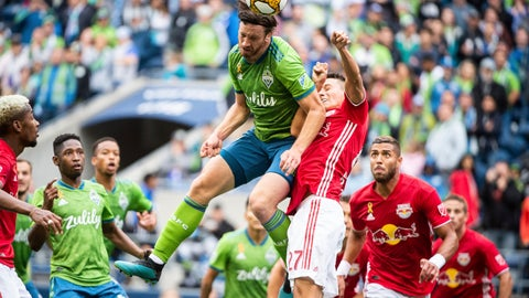 <p>               Seattle Sounders defender Gustav Svensson (4) goes up for header against New York Red Bulls midfielder Sean Davis (27) on Sunday, Sept. 15, 2019, in the first half of a MLS soccer match at CenturyLink Field in Seattle, Wash. (Joshua Bessex/The News Tribune via AP)             </p>