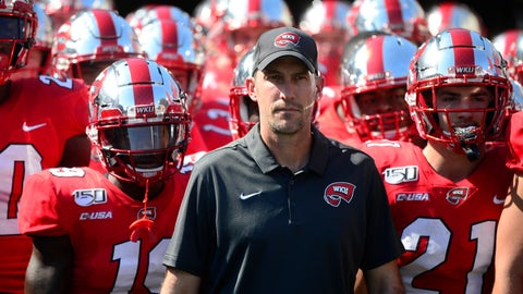 <p>               Western Kentucky head coach Tyson Helton prepares to lead his team out to the field at the start of an NCAA college football game against Louisville, Saturday, Sept. 14, 2019, in Nashville, Tenn. (AP Photo/Mike Strasinger)             </p>