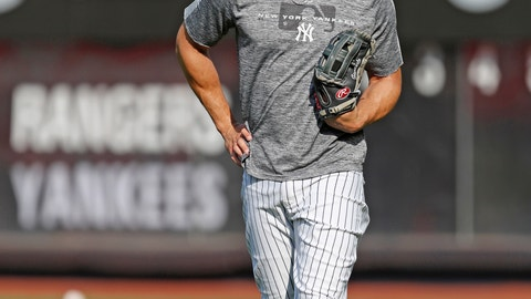 <p>               New York Yankees' Giancarlo Stanton, who has been out the much of the season with injuries and is still on the IL, stands in the outfield after a workout before the team's baseball game against the Texas Rangers, Wednesday, Sept. 4, 2019, in New York. (AP Photo/Kathy Willens)             </p>