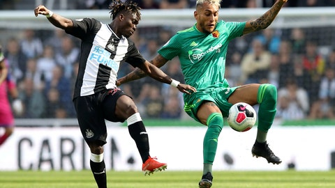 <p>               Newcastle United's Christian Atsu, left, and Watford's Roberto Pereyra battle for the ball during the English Premier League soccer match at St James' Park, London, Saturday Aug. 31, 2019. (Owen Humphreys/PA via AP)             </p>