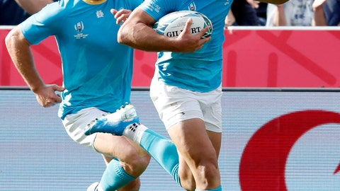 <p>               Juan Manuel Cat of Uruguay, right, celebrates after scoring a try during the Rugby World Cup Pool D match between Fiji and Uruguay in Kamaishi, northeastern Japan, Wednesday, Sept. 25, 2019. (Satoru Yonemaru/Kyodo News via AP)             </p>