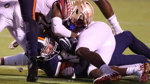 <p>               Virginia running back Wayne Taulapapa (21) scores a touchdown under Florida State defensive back Cyrus Fagan (24) during the first half of an NCAA college football game in Charlottesville, Va., Saturday, Sept. 14, 2019. (AP Photo/Andrew Shurtleff)             </p>