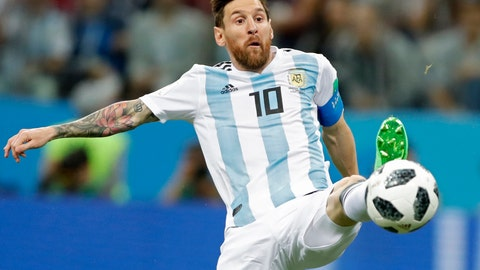 <p>               FILE - In this June 21, 2018 file photo Argentina's Lionel Messi reaches for the ball during the group D match between Argentina and Croatia at the 2018 soccer World Cup in Nizhny Novgorod Stadium in Nizhny Novgorod, Russia. Five-time winner Lionel Messi along with Cristiano Ronaldo and Virgil van Dijk are the three finalists for the FIFA best player award.  (AP Photo/Ricardo Mazalan)             </p>