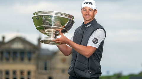 <p>               Victor Perez shows off the trophy following his win of the Links Championship at St Andrews in Scotland, Sunday Sept. 29, 2019. (Kenny Smith/PA via AP)             </p>
