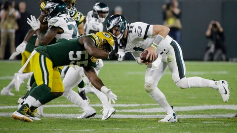 <p>               Philadelphia Eagles quarterback Carson Wentz scrambles to break free from the defense of Green Bay Packers outside linebacker Za'Darius Smith during the first half of an NFL football game Thursday, Sept. 26, 2019, in Green Bay, Wis. (AP Photo/Mike Roemer)             </p>