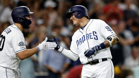 <p>               San Diego Padres' Manny Machado, right, reacts with teammate Eric Hosmer after hitting a two-run home run during the sixth inning of a baseball game against the Colorado Rockies, Saturday, Sept. 7, 2019, in San Diego. (AP Photo/Gregory Bull)             </p>