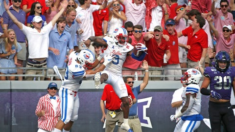 <p>               SMU wide receiver James Proche (3) celebrates with teammate and tight end Kylen Granson (83) after catching a touchdown pass as TCU linebacker Garret Wallow (30) looks on during the first half of an NCAA college football game Saturday, Sept. 21, 2019, in Fort Worth, Texas. (AP Photo/Ron Jenkins)             </p>