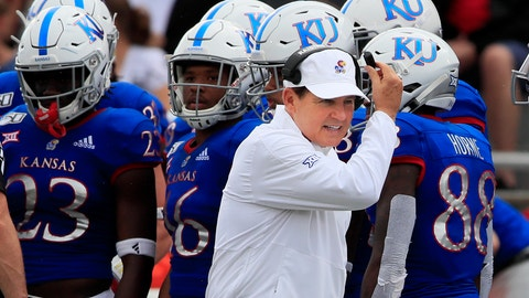 <p>               Kansas head coach Les Miles works the sidelines during the first half of an NCAA college football game against West Virginia in Lawrence, Kan., Saturday, Sept. 21, 2019. (AP Photo/Orlin Wagner)             </p>
