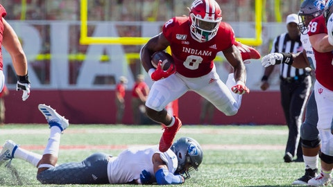 <p>               Indiana running back Stevie Scott III (8) is tripped up as he rushes the ball out of the backfield during the first half of an NCAA college football game against Easter Illinois, Saturday, Sept. 7, 2019, in Bloomington, Ind. (AP Photo/Doug McSchooler)             </p>