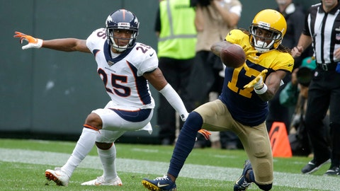 <p>               Green Bay Packers wide receiver Davante Adams (17) catches a pass as Denver Broncos cornerback Chris Harris defends during the first half of an NFL football game Sunday, Sept. 22, 2019, in Green Bay, Wis. (AP Photo/Mike Roemer)             </p>