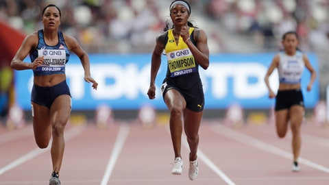 <p>               Orlann Ombissa-Dzangue, of France, and Elaine Thompson, of Jamaica, compete in a women's 100 meter heat at the World Athletics Championships in Doha, Qatar, Saturday, Sept. 28, 2019. (AP Photo/Petr David Josek)             </p>